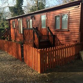 Beautiful 2 bedroomed log cabin in much sought after village. Great commute location