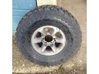 1x4x4mud tyre on alloy rim