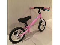 Pink baby balance bike from Decathlon