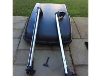 VW. roof bars and top box.