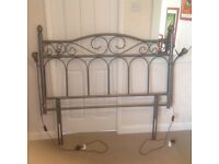 Metal double headboard with attached side lamps which are removable