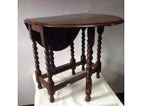 Oak gateleg oval dining table