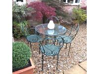 Wrought Iron Patio Set of 4 chairs and glass top table Handmade in fantastic condition