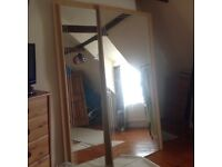 Large mirrored sliding wardrobe doors