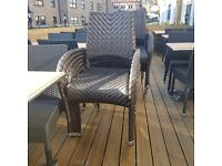 Outdoor 12 solid rattan chairs and 3 solid wooden tables in good condition.