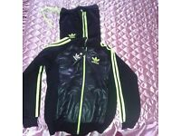 Adidas woman tracksuit black and green