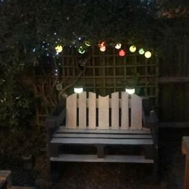 Garden furniture with euro-pallet benches