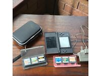 DS Lite, charger, eight games and carry case
