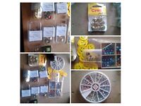 A Job lot of cardmaking items, card paper, artificial flowers and embellishments