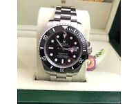 Silver Submariner Rolex with black face & bezel