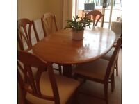 Solid elm extending oval table and 6 chairs. Table size 100cm W, 154cm L, extending to 200cm.