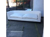Large light cream fabric sofa. Can deliver.