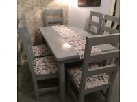 Lovely Dining Table and 6 solid chairs
