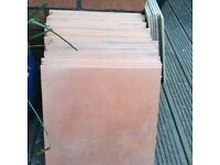 Terracotta colour floor tiles