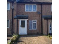 Unfurnished 2 bed terrace house with off-road parking, for rent.