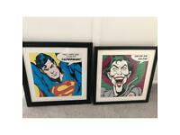 Two superhero framed pictures