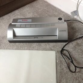 A4 laminator with pack of laminator pouches