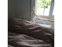 Cream iron bed, can sell with very comfortable mattress and bedding