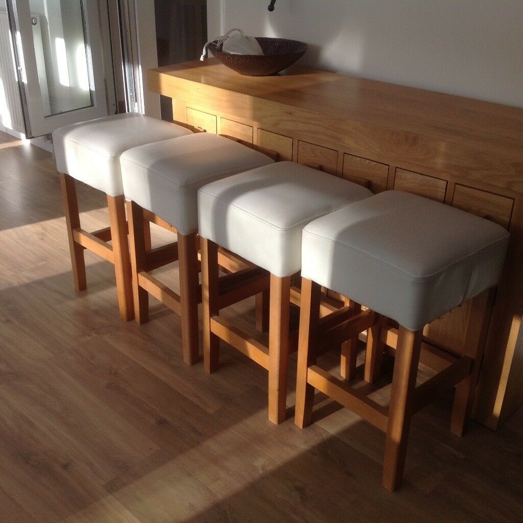 Four Oak Bar Stools With Cream Faux Leather Seats In Perth And