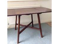 Ercol dark wood dining table