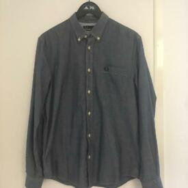 Various men's polos and jackets in small and medium