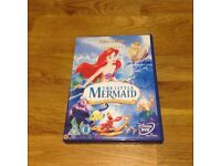 disney dvds the little mermaid. beauty and the beast. sleeping beauty
