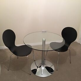 Round glass kitchen table- 80cm diameter and two black chairs- £70!