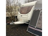 Caravan with fixed bed and full awning