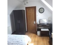 Wardrobe, dressing table, mirroe and double bed.