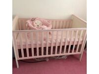 Pink cot and bouncer