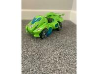 Dinosaur transforming toy car with music and lights