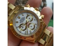 Brand New Gold Rolex Daytona. white face, Comes Rolex bagged, Boxed with paperwork.