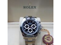 Silver with black face Daytona Rolex. Complete with Box, Bag & Paperwork