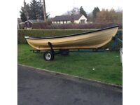 15ft double bowed row boat the hulls in good condation gunnels need a bitof tlc and so do the seats