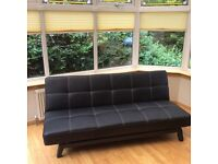 Leather look sofa/ bed for sale