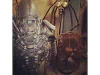 Lifesize alien metal sculpture