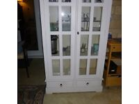 tall white glass fronted cupboard