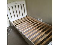 White wash wooden single bed and trundle