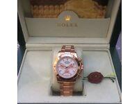 Rose Gold Rolex Daytona with White Face in Rilex Bag and Rolex Box