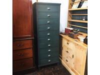 Antique bank of filing drawers
