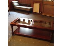 """Nice coffee table, good condition. Glass top. 47"""" by 17"""""""