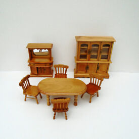 7 Piece set of dolls house furniture in perfect condition.