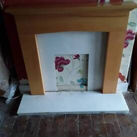 Solid marble with pine fire surround