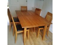 Oak Dining Table and 8 chairs, seats 6 and extends to 8