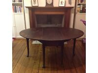 Drop leaf dining table.