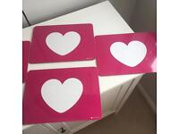 Three pink and white heart placemats
