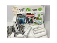 Wii bundle including balance board and 4 games.