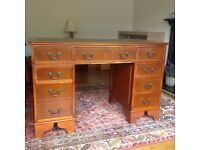 Leather-topped rosewood desk with character. Ideal for office or home use.