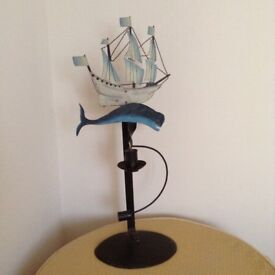 Ship and balancing/swinging whale with candle holder