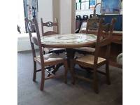 Farmhouse Style Round Lemon Design Tiled Dining Table. 4 Wicker Seat Chairs